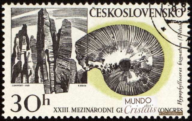 Mountains and fossil on post stamp